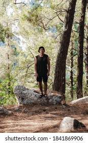 photo of a guy in a green forest near Mount Olympus