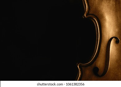 Photo with half a violin on a black background