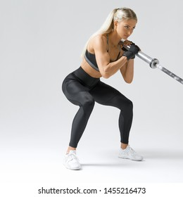 Photo of hamstring, quad and booty workout Attractive fitness model workout with barbell row Sporty woman on white background Perfect fit fitness model with barbell