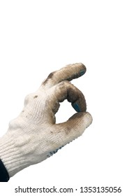 photo of hand in a dirty working white knitted cotton glove shows gesture okay isolated on white background closeup