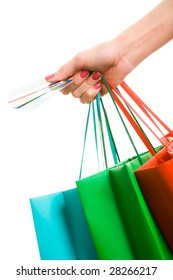 Photo of hand holding shopping bags and three credit cards