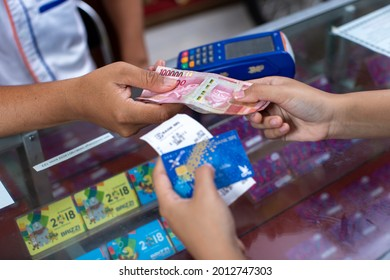 photo of hand and money transactions using edc machines and debit cards to withdraw cash which makes the payment process and withdrawing money easier, Tegal-Indonesia.December 18 2018