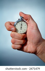 Photo of a Hand with a Stopwatch