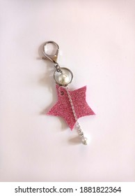 Photo of handmade star keychain made with glitter foam sheet on white background