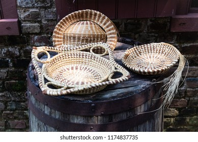 A photo of hand-made sweetgrass baskets made in the Gullah-Geechee style of Lowcountry, South Carolina.