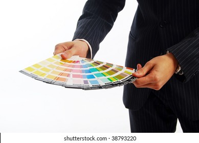 Photo of hands holding a color guide