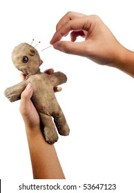 photo of hands holding creepy voodoo doll isolated on white
