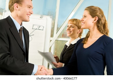 Photo of handshake of businesspeople during meeting in the office