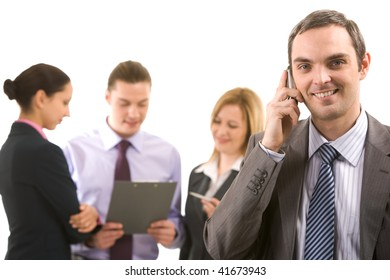 Photo of handsome employer calling his partner with working employees behind