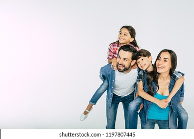 Photo of happy beautiful family isolated on white and looking away