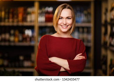 Photo of happy blonde in store with wine