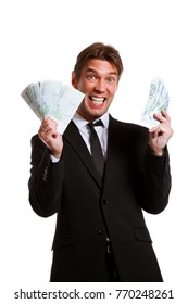 Photo of happy businessman in suit with euro at hands