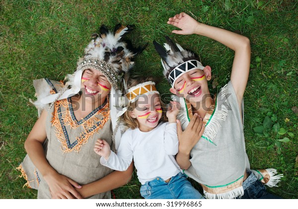 photo of happy children with native american costumes