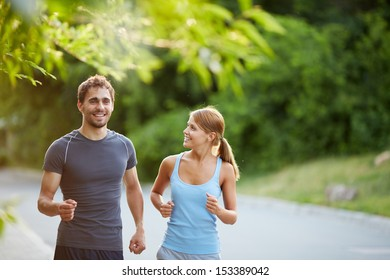 Photo of happy couple jogging on summer morning