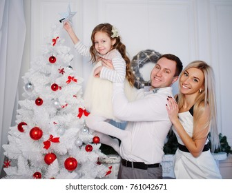 photo of happy family celebrating christmas at home
