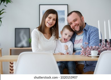 Photo of happy family with son in room