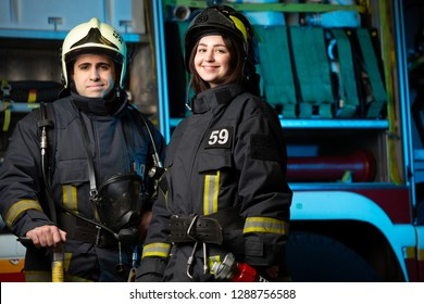 Photo of happy fireman and woman near fire truck