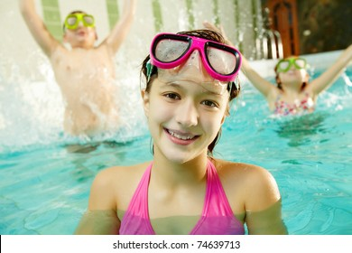 Photo of happy girl in pool with her friends having fun on background