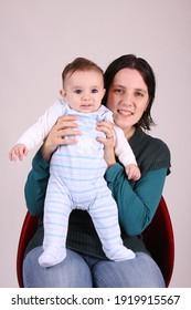 photo of happy mother with happy baby, studio photo