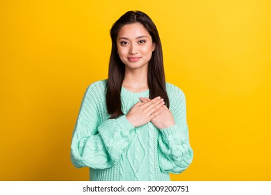 Photo of happy nice charming woman hold hands heart honest smile isolated on yellow color background