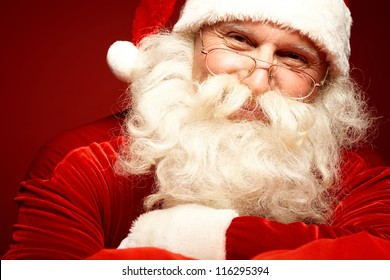 Photo of happy Santa Claus in eyeglasses looking at camera