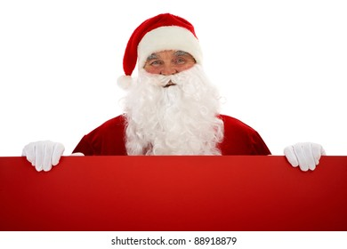 Photo of happy Santa Claus with red billboard