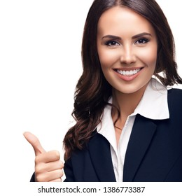 Photo of happy smiling beautiful young businesswoman showing thumbs up gesture, isolated against white background