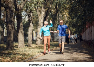 Photo of happy sporting man and woman doing handshake on morning jog