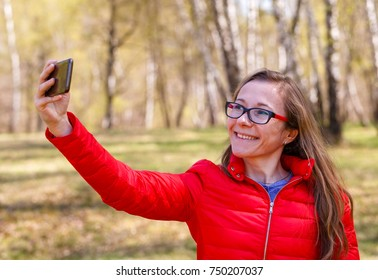 Photo of happy young girl taking selfie