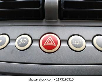 Photo of hazard lamp button.