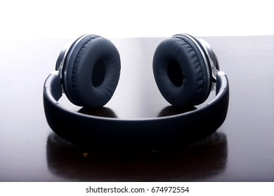 Photo of headphones on a wooden table.