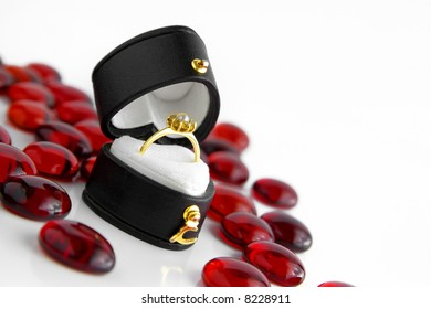 Photo of a heart-shaped box with engagement ring.