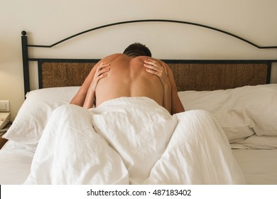 Photo of the Heterosexual Couple having passionate sex in bed. Passion , love concept.