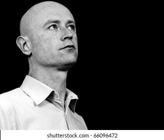 photo high contrast dark moody portrait capture 30's male on black backdrop