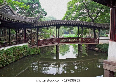 Photo of the Humble Administrator Garden in Suzhou near Shanghai with an a bridge and passageway above pond, China, stylized and filtered to resemble an oil painting.