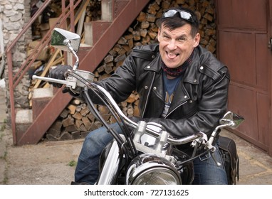 Photo of humor. The biker makes a funny facial expression.