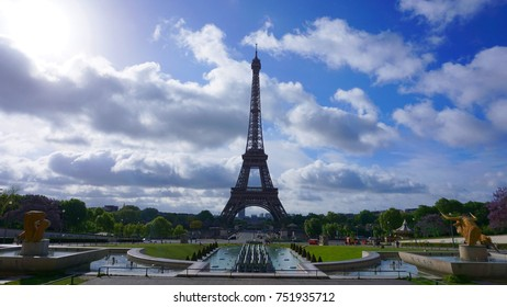 Photo of iconic Eiffel Tower as seen from Trocadero gardens with beautiful scattered clouds on a spring morning, Paris, France