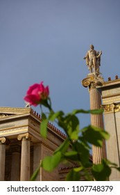 Photo of iconic neoclassic Academy of Athens as seen from beautiful red rose garden, Athens historic center, Attica, Greece