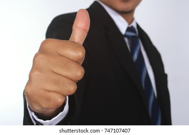 Photo image of businessman with thumb up hand isolated on white