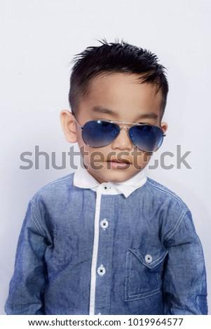 d820dfa7e Photo image of cute asian little boy in elegant clothes and sunglasses. Kids  fashion.