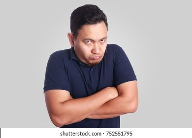 Photo image of funny Asian man showing synical unhappy angry facial expression