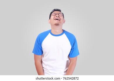 Photo image of funny Asian man crying close his eyes, sad depression frustration hopeless expression