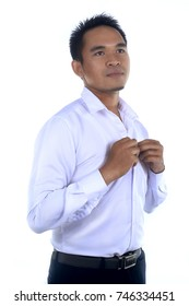 Photo image of a handsome attractive young Asian businessman dressing, button up his shirt. Ready to work in formal wear