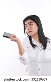 Photo image portrait of a beautiful cute young Asian woman looking sad to give her credit card, economic depression, bankruptcy concept, close up portrait over white background