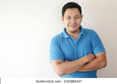 Photo image portrait of funny young attractive cute Asian man smiling happily, with arms crossed