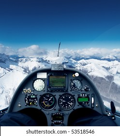 Photo inside the cockpit of a glider flying over the alps