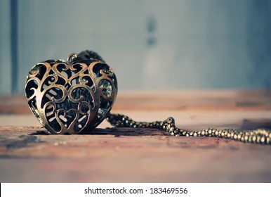 Photo of iron heart on wooden background