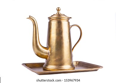 photo of isolated old-style coffee pot made of brass