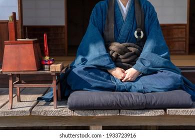 A photo of a Japanese monk doing zazen
