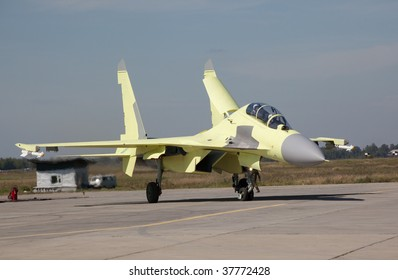 photo of jet fighter Su-30MK just landed.  This plane is completely new - it is without camouflage painting